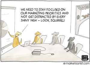 Dogs talking about marketing see a squirrel.